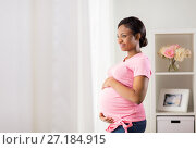 Купить «happy pregnant woman with big belly at home», фото № 27184915, снято 4 августа 2017 г. (c) Syda Productions / Фотобанк Лори