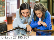 Купить «Mother and daughter enjoying expositions of previous centuries», фото № 27185867, снято 12 декабря 2017 г. (c) Яков Филимонов / Фотобанк Лори