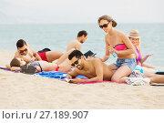 Купить «People applying suntan lotion and resting», фото № 27189907, снято 23 мая 2019 г. (c) Яков Филимонов / Фотобанк Лори