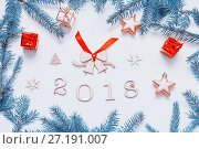 Купить «New Year 2018 background with 2018 figures,Christmas toys, fir branches-New Year 2018 composition», фото № 27191007, снято 30 ноября 2016 г. (c) Зезелина Марина / Фотобанк Лори