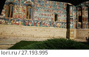 Купить «Image of frescoes of church in Sucevita Monastery on Bucovina in Romania.», видеоролик № 27193995, снято 7 октября 2017 г. (c) Яков Филимонов / Фотобанк Лори