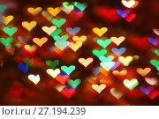 Разноцветные блики от новогодней гирлянды в форме сердец. Стоковое фото, фотограф Юлия Болоцкая / Фотобанк Лори