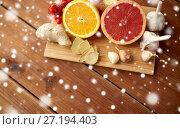 Купить «citrus, ginger, garlic and rowanberry on wood», фото № 27194403, снято 13 октября 2016 г. (c) Syda Productions / Фотобанк Лори