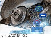 Купить «car brake disc at repair station», фото № 27194683, снято 1 июля 2016 г. (c) Syda Productions / Фотобанк Лори