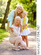 Купить «happy mother, daughter and grandmother at park», фото № 27194747, снято 11 августа 2017 г. (c) Syda Productions / Фотобанк Лори