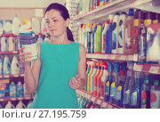 Купить «Woman choosing dishwashing liquid on supermarket shelf», фото № 27195759, снято 6 июня 2017 г. (c) Яков Филимонов / Фотобанк Лори