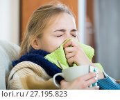 Купить «Adult female under blanket with flu attack indoors», фото № 27195823, снято 25 июня 2019 г. (c) Яков Филимонов / Фотобанк Лори