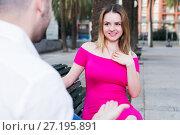 Купить «Young female is flirting with guy», фото № 27195891, снято 18 октября 2017 г. (c) Яков Филимонов / Фотобанк Лори