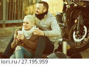 Купить «couple posing near motor bike with sandwitches and coffee», фото № 27195959, снято 22 октября 2018 г. (c) Яков Филимонов / Фотобанк Лори