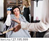 Купить «Brunette woman is upset by her haircut», фото № 27195999, снято 7 марта 2017 г. (c) Яков Филимонов / Фотобанк Лори