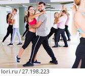 Купить «Sports dancing pair dance together», фото № 27198223, снято 9 октября 2017 г. (c) Яков Филимонов / Фотобанк Лори