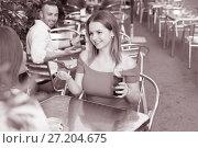 Купить «Young man is watching girls and wants to acquaintance with them», фото № 27204675, снято 18 октября 2017 г. (c) Яков Филимонов / Фотобанк Лори