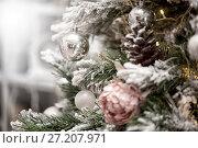 Купить «decorations on a Christmas tree and glare of lights», фото № 27207971, снято 4 ноября 2017 г. (c) katalinks / Фотобанк Лори