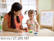 Купить «Mother with kid having fun time together», фото № 27209187, снято 1 ноября 2017 г. (c) Оксана Кузьмина / Фотобанк Лори
