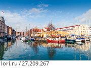 Купить «Quay of the Christianshavn canals in Copenhagen with boats, plea», фото № 27209267, снято 10 марта 2012 г. (c) Ольга Визави / Фотобанк Лори