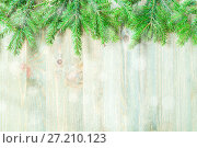 Купить «Winter background. Green fir tree branches with winter snowflakes on the wooden background. Winter still life with free space for text», фото № 27210123, снято 8 мая 2017 г. (c) Зезелина Марина / Фотобанк Лори