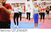 Купить «Group women are doing self-defence-karate moves with trainer in sporty gym.», видеоролик № 27214631, снято 23 октября 2017 г. (c) Яков Филимонов / Фотобанк Лори
