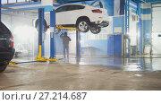 Купить «Washing luxury SUV under bottom in the suds by water hoses - under bottom, close up», фото № 27214687, снято 19 ноября 2017 г. (c) Константин Шишкин / Фотобанк Лори