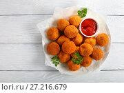 Купить «delicious potato croquettes with tomato sauce», фото № 27216679, снято 7 ноября 2017 г. (c) Oksana Zh / Фотобанк Лори