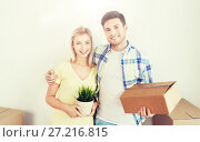 Купить «smiling couple with big boxes moving to new home», фото № 27216815, снято 25 февраля 2016 г. (c) Syda Productions / Фотобанк Лори