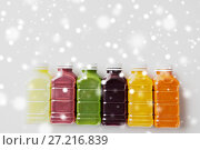 Купить «bottles with different fruit or vegetable juices», фото № 27216839, снято 5 августа 2016 г. (c) Syda Productions / Фотобанк Лори