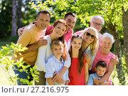 Купить «happy family portrait in summer garden», фото № 27216975, снято 9 июля 2017 г. (c) Syda Productions / Фотобанк Лори
