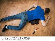 Купить «dead man body lying on floor at crime scene», фото № 27217059, снято 5 мая 2017 г. (c) Syda Productions / Фотобанк Лори
