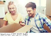 Купить «smiling couple with big boxes moving to new home», фото № 27217143, снято 25 февраля 2016 г. (c) Syda Productions / Фотобанк Лори