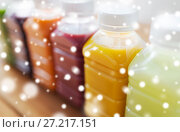 Купить «bottles with different fruit or vegetable juices», фото № 27217151, снято 5 августа 2016 г. (c) Syda Productions / Фотобанк Лори