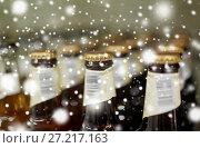 Купить «close up of bottles at liquor store», фото № 27217163, снято 2 ноября 2016 г. (c) Syda Productions / Фотобанк Лори