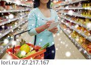 Купить «customer with shopping basket at supermarket», фото № 27217167, снято 2 ноября 2016 г. (c) Syda Productions / Фотобанк Лори