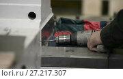 Купить «Drilling holes in a metal surface using a hand-held electric drill», видеоролик № 27217307, снято 7 ноября 2017 г. (c) Андрей Радченко / Фотобанк Лори