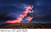 Купить «Woman running fast against stormy sky with flash», фото № 27221023, снято 11 июня 2017 г. (c) Сергей Новиков / Фотобанк Лори