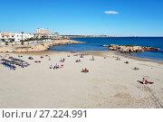 Купить «People sunbathing at the Cala Capitan beach. Spain», фото № 27224991, снято 5 ноября 2017 г. (c) Alexander Tihonovs / Фотобанк Лори