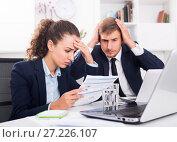 Купить «sad man and upset woman coworkers in firm office», фото № 27226107, снято 31 мая 2020 г. (c) Яков Филимонов / Фотобанк Лори