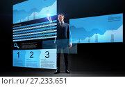 Купить «businessman with stock charts on virtual screens», фото № 27233651, снято 9 марта 2017 г. (c) Syda Productions / Фотобанк Лори