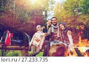 Купить «family with smartphone taking selfie near campfire», фото № 27233735, снято 27 сентября 2015 г. (c) Syda Productions / Фотобанк Лори