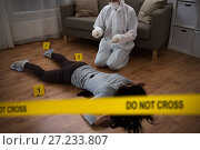 Купить «criminalist collecting evidence at crime scene», фото № 27233807, снято 5 мая 2017 г. (c) Syda Productions / Фотобанк Лори