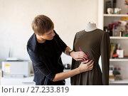 Купить «fashion designer with dummy making dress at studio», фото № 27233819, снято 28 июня 2017 г. (c) Syda Productions / Фотобанк Лори