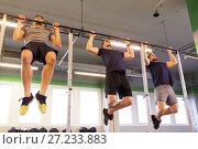 Купить «group of young men doing pull-ups in gym», фото № 27233883, снято 19 февраля 2017 г. (c) Syda Productions / Фотобанк Лори
