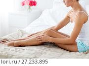 Купить «beautiful woman with bare legs on bed at home», фото № 27233895, снято 9 апреля 2017 г. (c) Syda Productions / Фотобанк Лори
