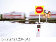 Купить «A stop sign at a railroad crossing», фото № 27234043, снято 30 декабря 2016 г. (c) bashta / Фотобанк Лори