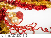 Купить «Christmas decorations of red and golden color on a white background - balls, beads,tinsel», фото № 27237115, снято 24 ноября 2017 г. (c) Юлия Бабкина / Фотобанк Лори