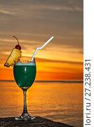 Купить «Glass of drink is on a beach table», фото № 27238431, снято 19 августа 2018 г. (c) М / Фотобанк Лори