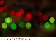 Купить «Abstract bokeh background of lights red and green on a dark», фото № 27238867, снято 26 ноября 2017 г. (c) Юлия Бабкина / Фотобанк Лори