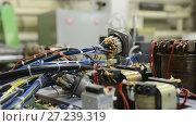 Купить «The control system of a modern CNC machine. Cable harnesses.», видеоролик № 27239319, снято 10 ноября 2017 г. (c) Андрей Радченко / Фотобанк Лори