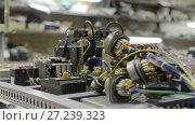 Купить «Electrical modules, switches, relays and cables are mounted on the circuit board», видеоролик № 27239323, снято 10 ноября 2017 г. (c) Андрей Радченко / Фотобанк Лори