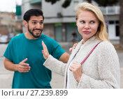 Купить «Husband and wife are emotional quarreling», фото № 27239899, снято 10 августа 2017 г. (c) Яков Филимонов / Фотобанк Лори
