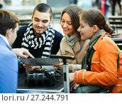 Купить «Tourists with map at street cafe», фото № 27244791, снято 27 февраля 2020 г. (c) Яков Филимонов / Фотобанк Лори
