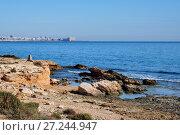 Купить «Rocky coastline of Torrevieja. Costa Blanca. Spain», фото № 27244947, снято 22 ноября 2017 г. (c) Alexander Tihonovs / Фотобанк Лори
